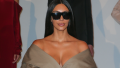 Kim Kardashian at Paris Fashion Week in 2016 wearing a green coat and black sunglasses