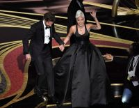 Lady Gaga Wearing a Black Dress With Bradley Cooper