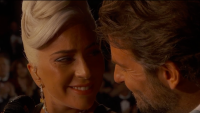 Lady Gaga and Bradley cooper smiling