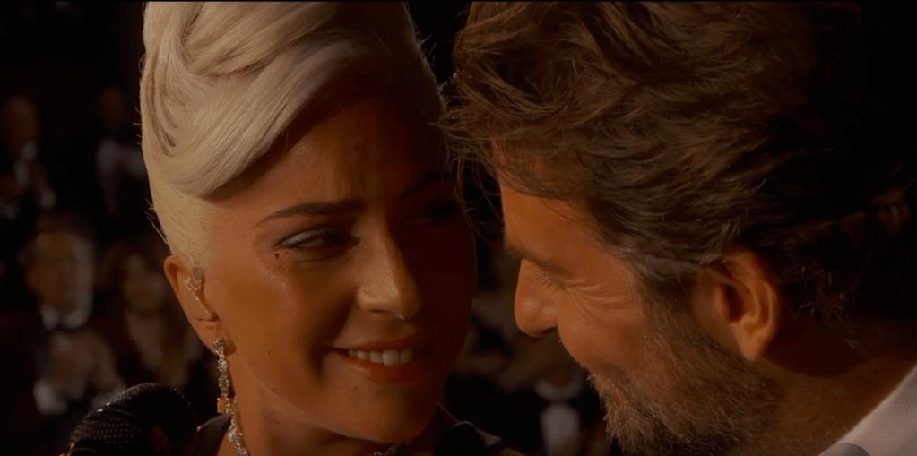 Lady Gaga and Bradley cooper smiling