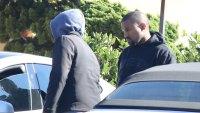 Kanye West looks glum amid family drama
