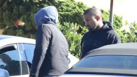 Kanye West looks glum amid family drama