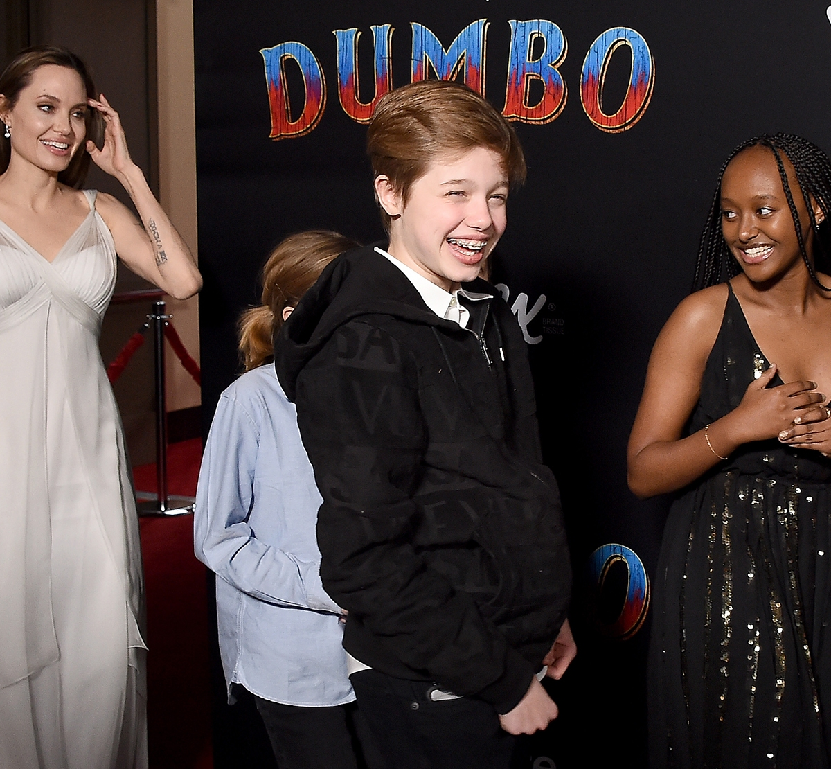 912376f37 Angelina Jolie Shows off Back Tattoos at 'Dumbo' Red Carpet With Kids
