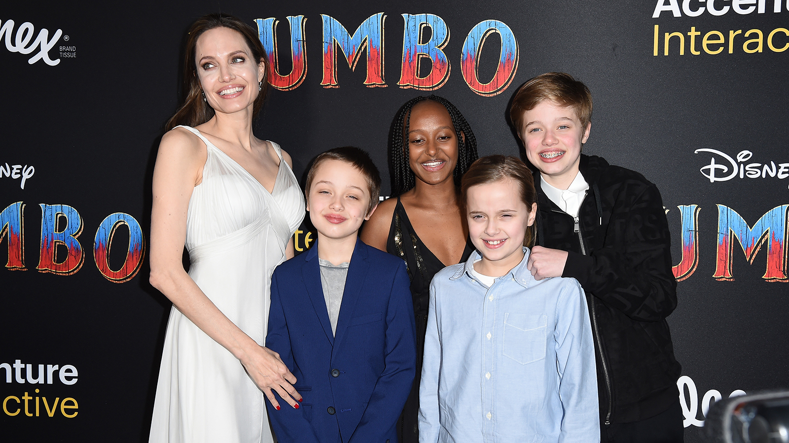 5f9590da9 Angelina Jolie Shows Off Back Tattoos While Hitting the 'Dumbo' Red Carpet  With Her Kids