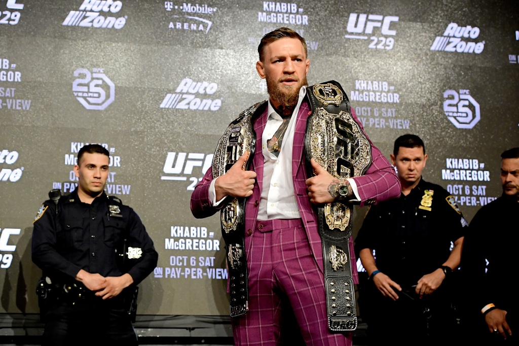 Conor McGregor wearing purple at an event