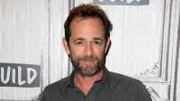Luke Perry wearing a button down shirt