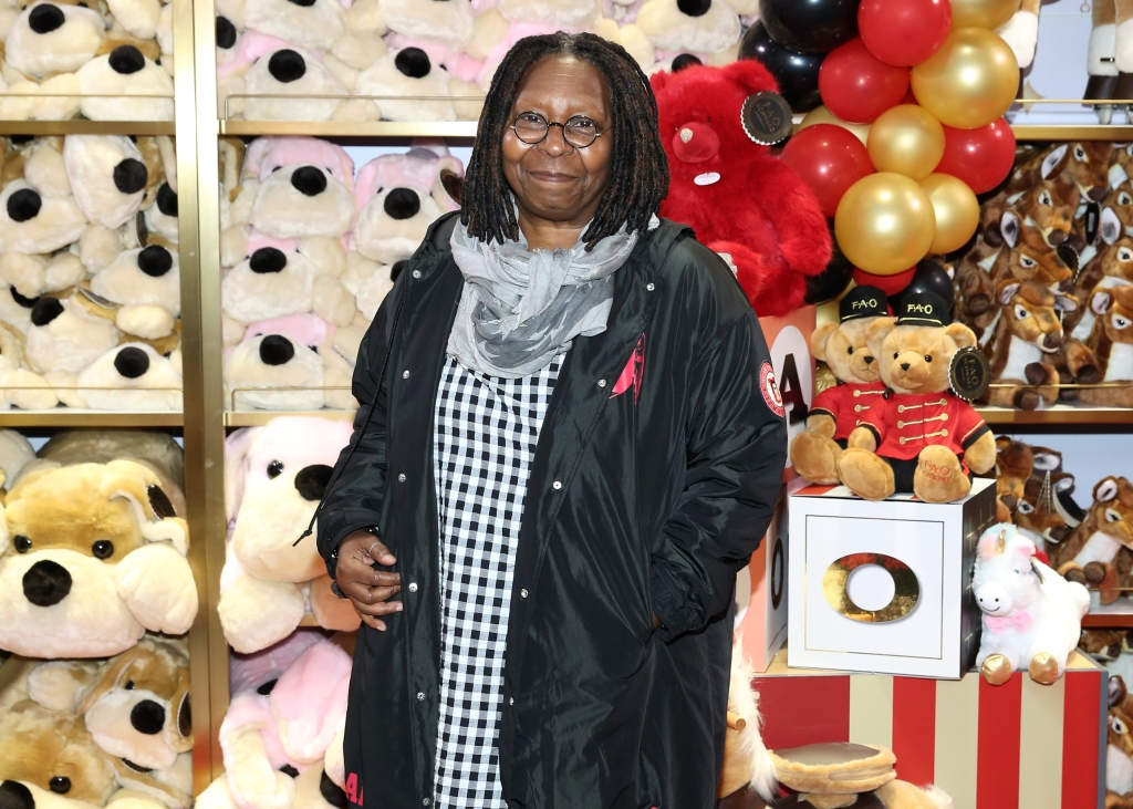 Whoopi Goldberg wearing a scarf and jacket at an event