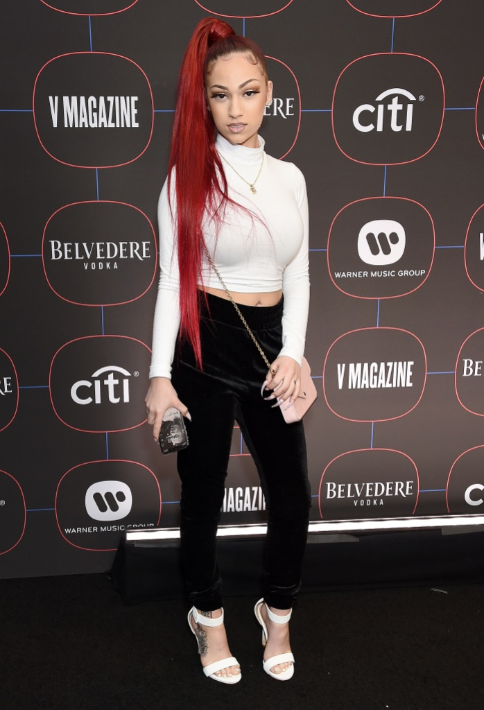 Danielle Bregoli at an event in a white shirt, red hair and black pants