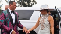alex rodriguez wearing a patterned suit with jennifer lopez