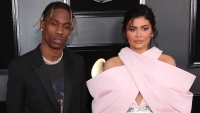 Kylie Jenner wearing a pink outfit with Travis Scott