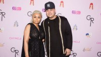 Rob Kardashian wearing black with Blac Chyna