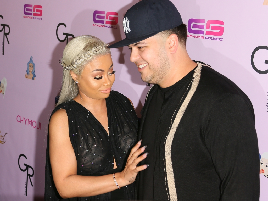 Rob Kardashian wearing a hat with Blac Chyna
