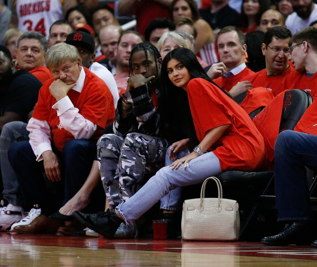 Kylie Jenner wearing red with Travis Scott
