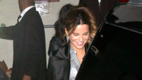 Kate Beckinsale smiling while getting into a black car