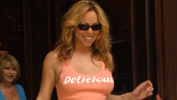 Mariah Carey wearing an orange shirt that says delicious.
