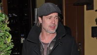 Brad Pitt wearing a hat and jacket