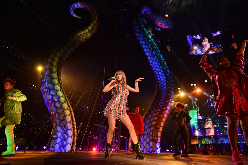 Taylor Swift in a Rainbow Outfit on Stage