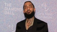 nipsey hussle wearing a black outfit