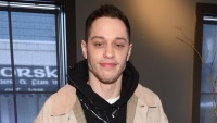 pete davidson wearing a jacket and giving a thumbs up