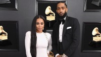 nipsey hussle with lauren london at the grammys