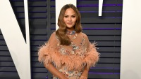 Chrissy Teigen Wearing a Pink Fluffy Dress at Oscar Party
