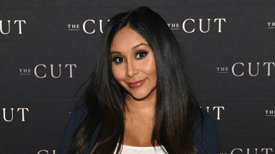 snooki wearing a sweater at an event