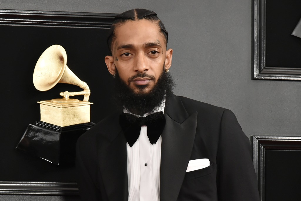 nipsey hussle wearing a suit at the grammys