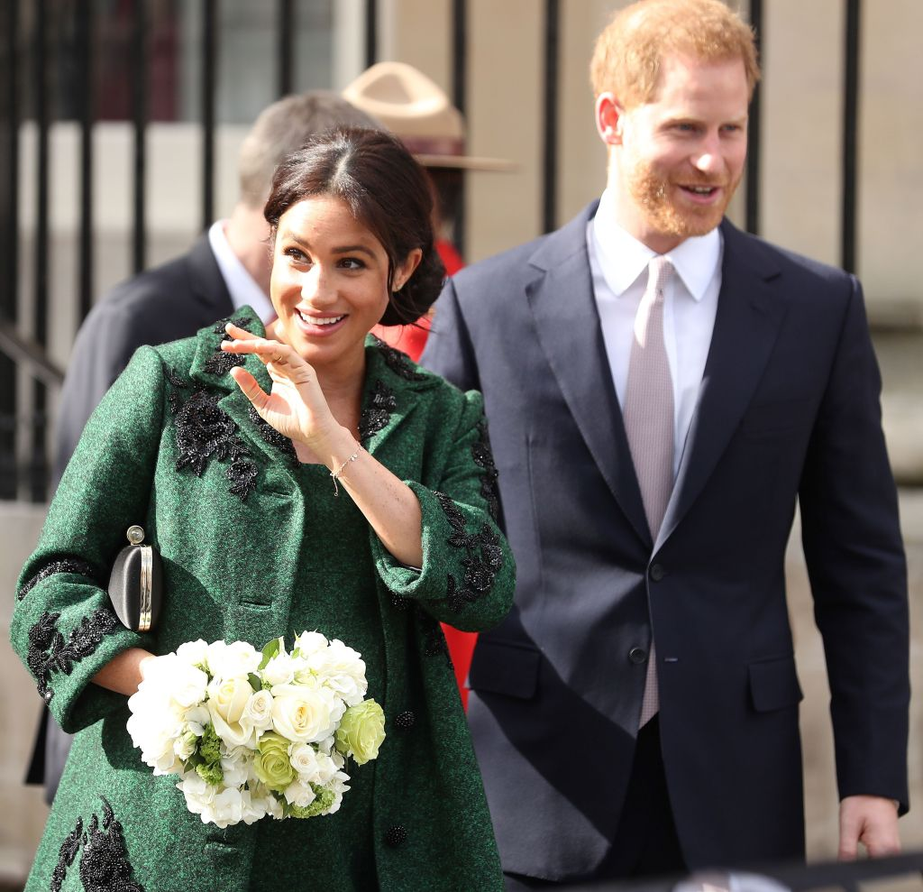 prince harry with meghan markle wearing a green dress
