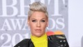 pink wearing a yellow dress with a leather jacket