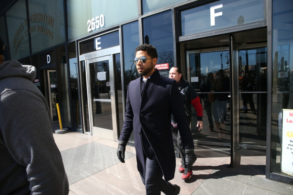 jussie smollett walking out a courtroom