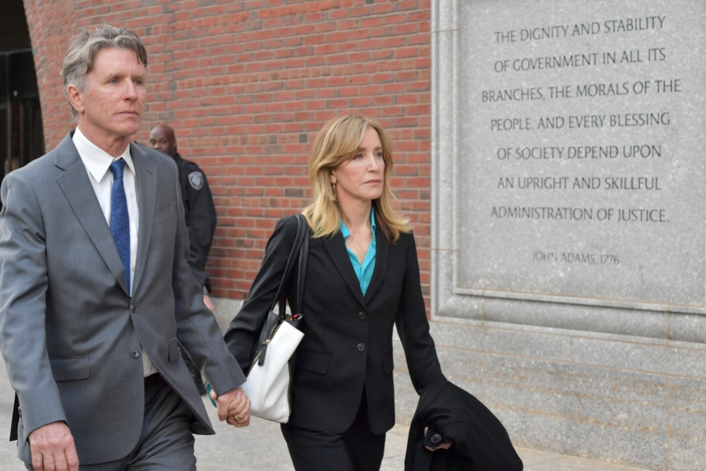 felicity huffman wearing a black suit to court