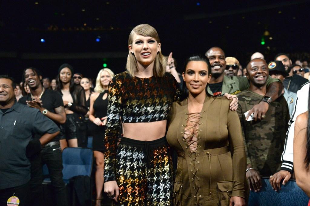 Taylor Swift smiling with Kim Kardashian