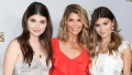 lori loughlin in a red dress with her two daughters