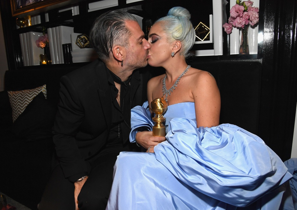 Lady Gaga in a Blue Dress with Christian Carino Kissing