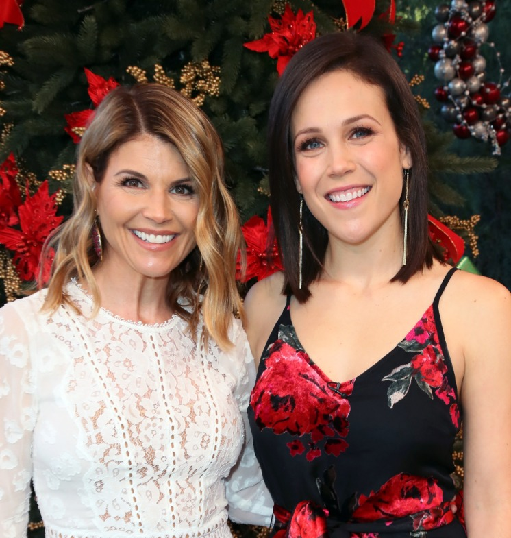 Lori Loughlin Wearing a White Dress with Erin Krakow