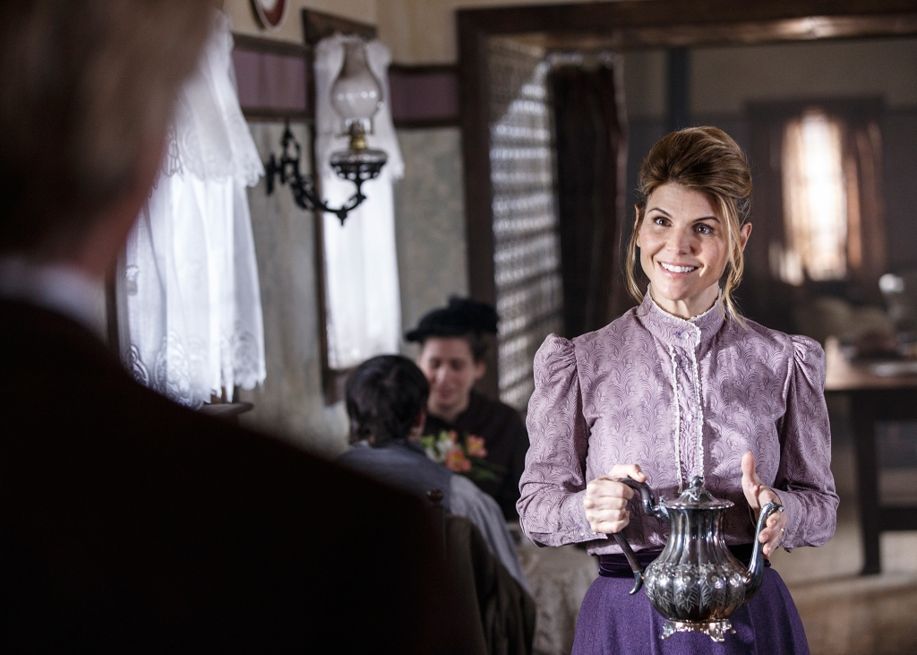 Lori Loughlin on the Set of Her Show When Calls the Heart Wearing a Purple Dress