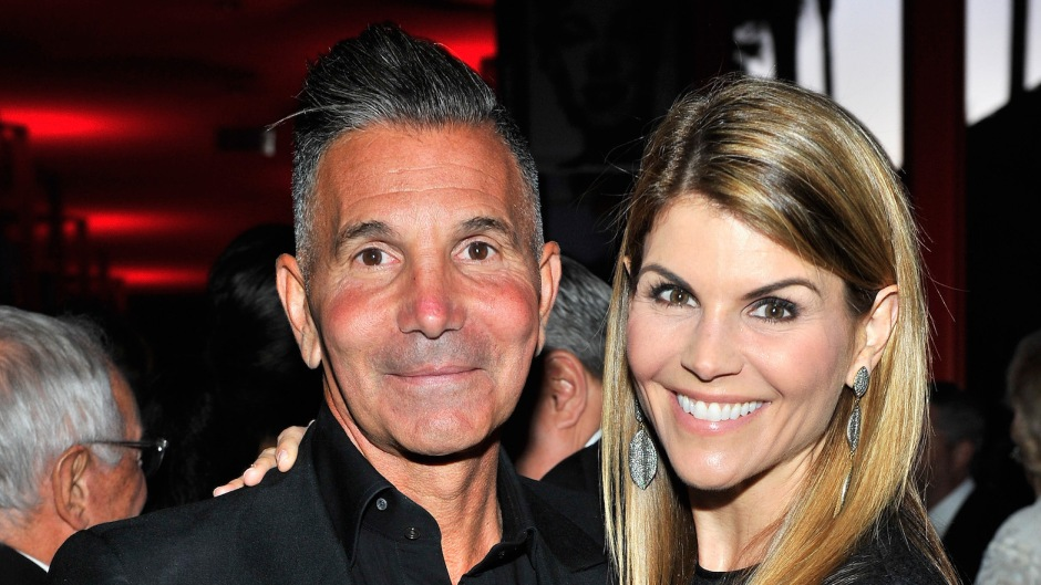 Lori Loughlin with her husband Mossimo at an event wearing black