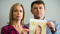 Parents of missing girl Madeleine McCann, Kate (L) and Gerry McCann (R) pose with an artist's impression of how their daughter might look now at the age of nine ahead of a press conference in central London on May 2, 2012 five years after Madeleine's disappearance while on a family holiday in Portugal. Aged three at the time, the artist's impression depicts how Madeleine may now look, based on family photos of her, along with childhood images of her parents.