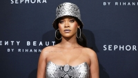 Rihanna Fires Back After Troll Tells Her to Go Back to Singing