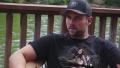 Ryan Edwards Wearing a Black Shirt and Baseball Hat