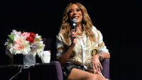 Wendy Williams Wearing a White Shirt on Stage
