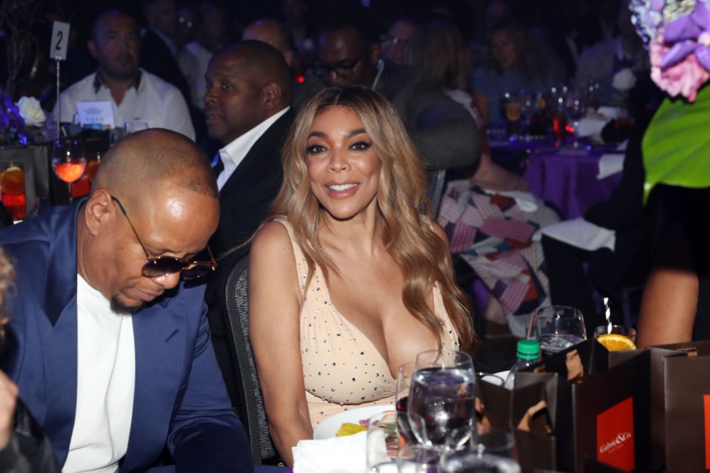 Wendy Williams Wearing a Tan Dress with Kevin Hunter in Sunglasses