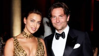 Irina Shayk Wearing a Gold Dress with Bradley Cooper at the Met Gala 2018