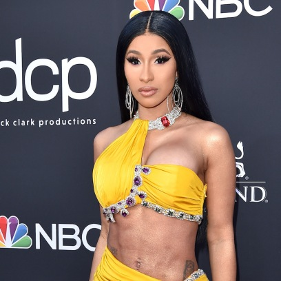 Cardi B Wearing a Yellow Dress With Her Abs Sticking Out at Event