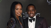 Kim Porter Wearing a Sequin Dress with Diddy