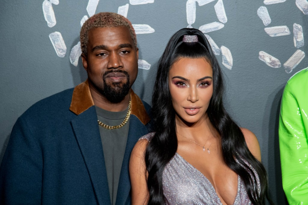 Kanye West Wearing a Blue Jacket with Kim Kardashian in a Gray Dress