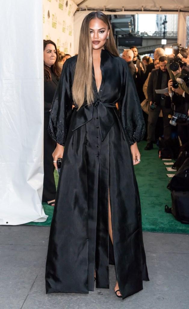 Chrissy Teigen Wearing a Black Dress in NYC