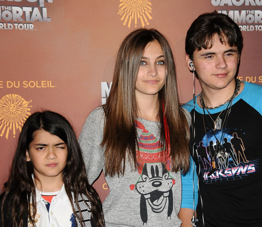 Paris Jackson Wearing a Gray Shirt with Her Brothers Blanket and Prince