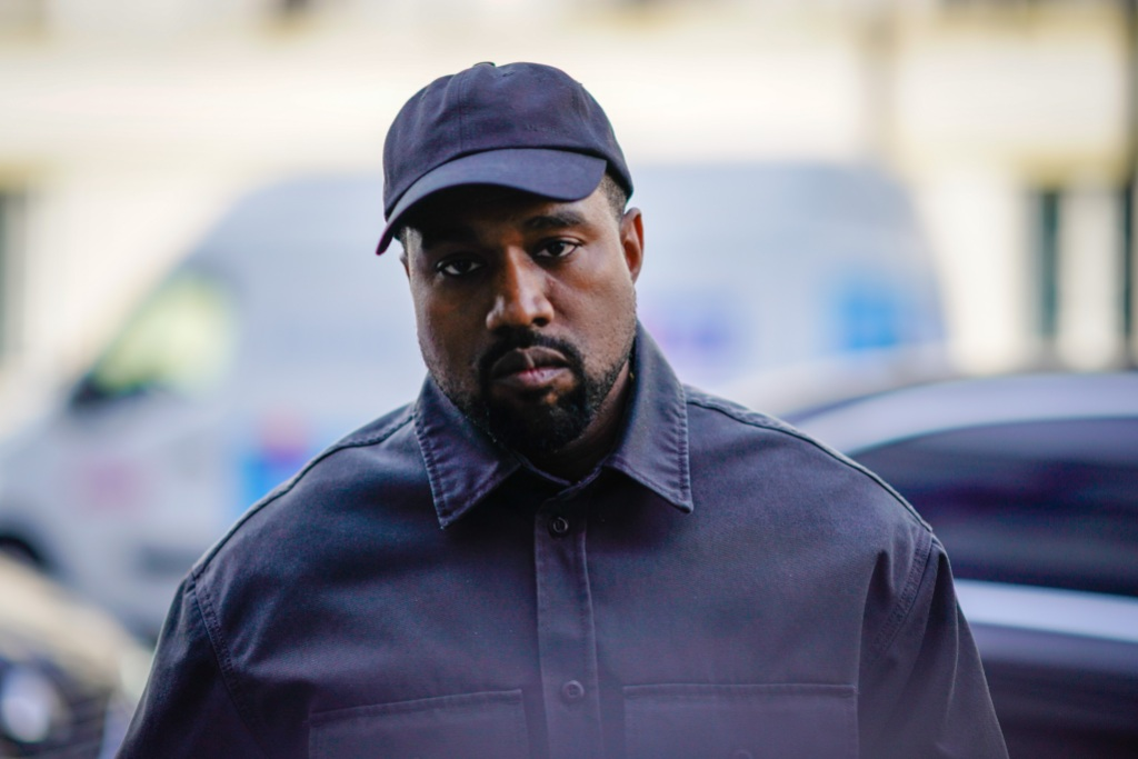 Kanye West Wearing a Black Outfit With a Hat