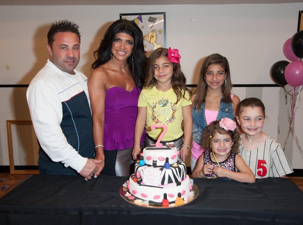 The Giudice Family With a Birthday Cake